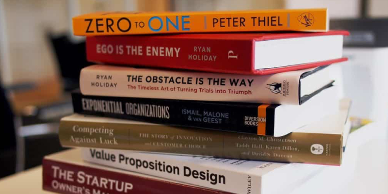 A Stack of Books Placed On The Table About Marketing Books For Startup Owners, Value preposition Design.