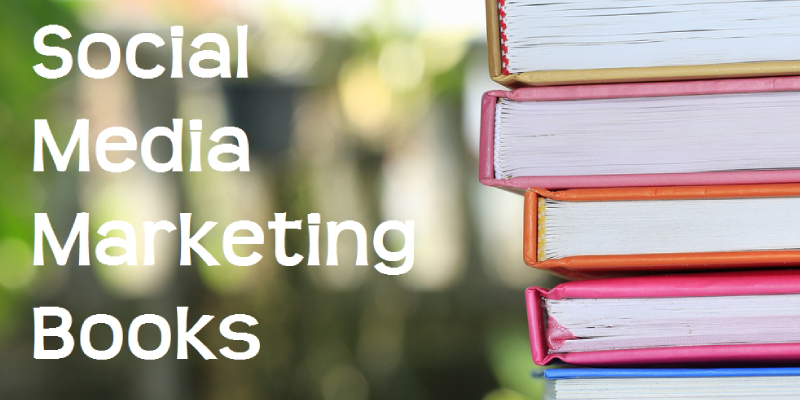 A Pile Of Books About Social Media Marketing In A Blurred Library Background.