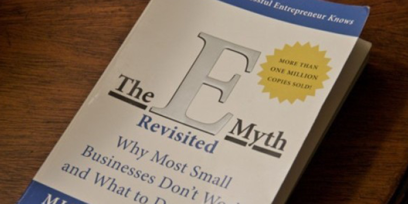 The EMyth Revisited - A Book About Online Marketing Placed On The Wooden Table.